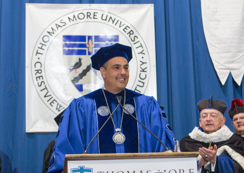 man smiling at podium