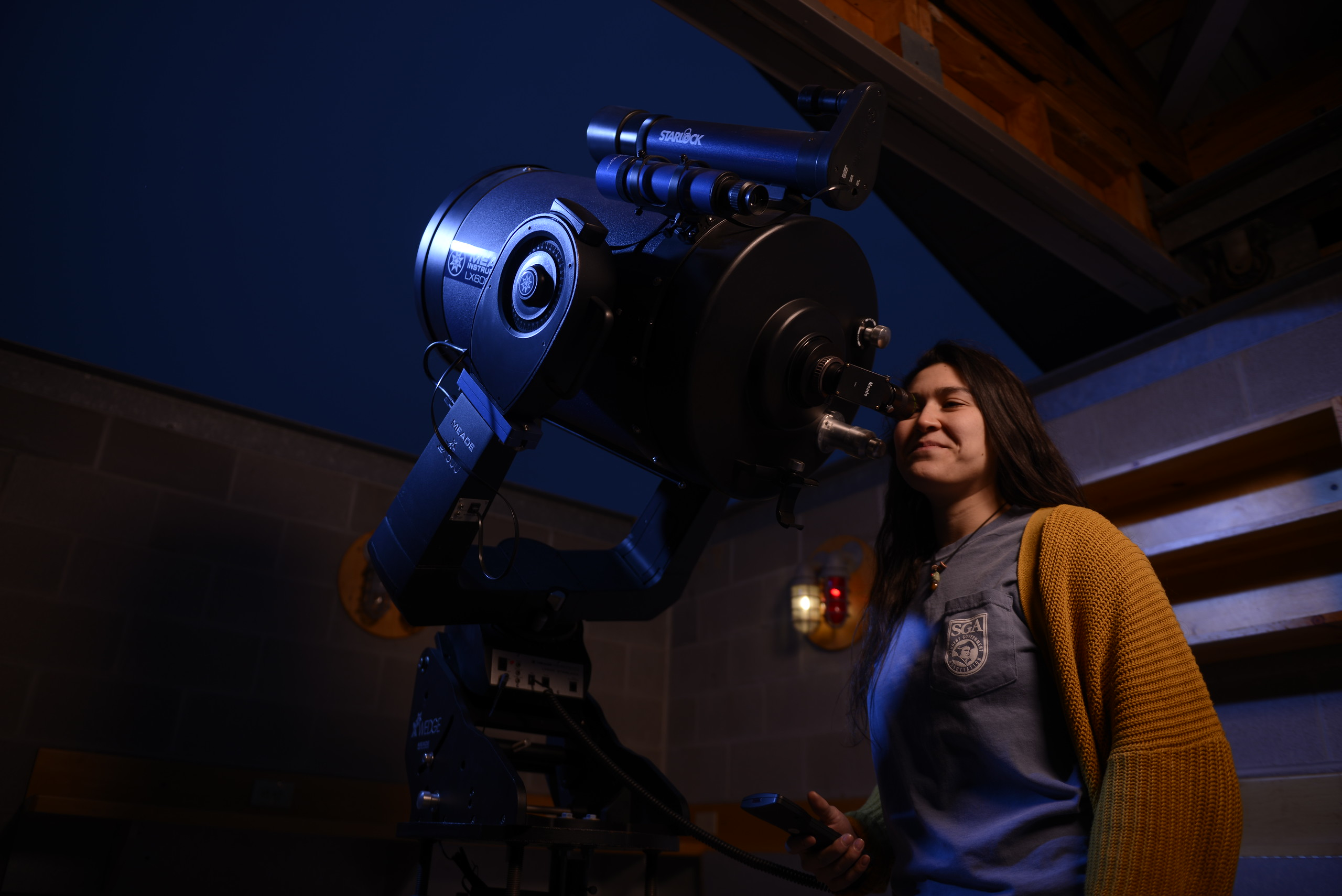 student using telescope